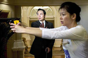Francis helps Vivian Hsu with her aim, One Last Dance, 2005